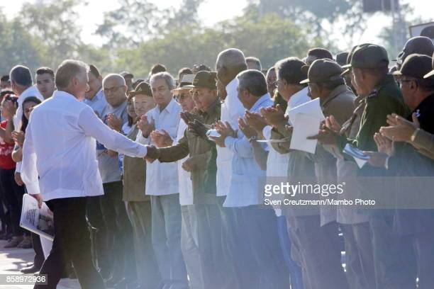 Cubas VicePresident Miguel DiazCanel is being greeted by Pesident Raul Castro after delivering a speech during apolitical act at the Plaza de la...