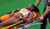 Cuba's Yargeris Savigne is taken away on a stretcher during the women's triple jump final at the International Association of Athletics Federations...