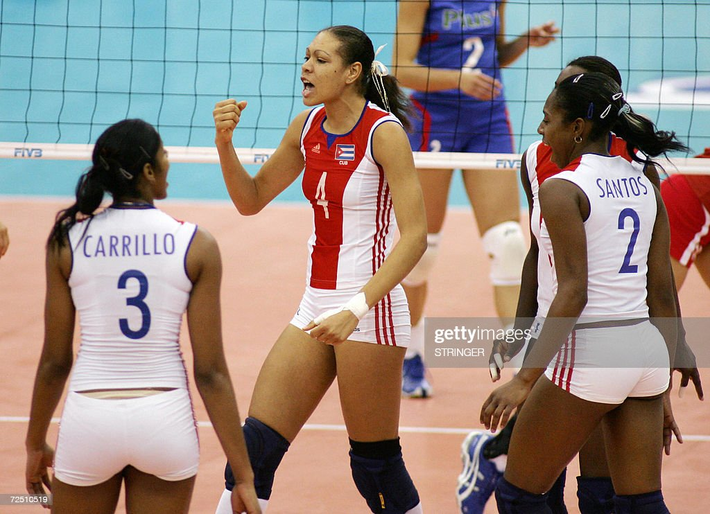 Cuba's Yenisei Gonzalez Dias (4) celebrates with Nancy Carrillo de la Paz (3) and Yanelis Santos Allegne (2) after scoring a point during the women's second round Pool E match against Poland in the Volleyball World Championships in Nagoya, central Japan 12 November 2006. Cuba defeated Poland 25-18, 28-26, 25-23. AFP PHOTO/Kimimasa MAYAMA
