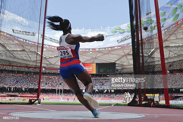 Cuba's Yirisleydi Ford competes in the qualifying round of the women's hammer throw athletics event at the 2015 IAAF World Championships at the...