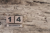 cube calendar for december on wooden background with copy space