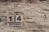 wooden cube calendar for september on wooden background with copy space