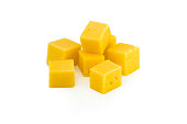 Cube of cheese isolated on a white background