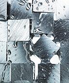 Cube of metal and splash water