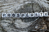 cube word prosperity on wooden table