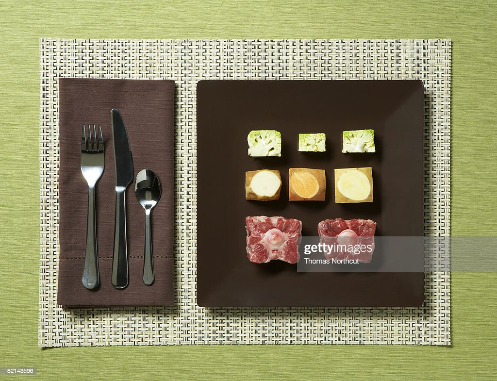 cubed raw food on a plate : Stock Photo