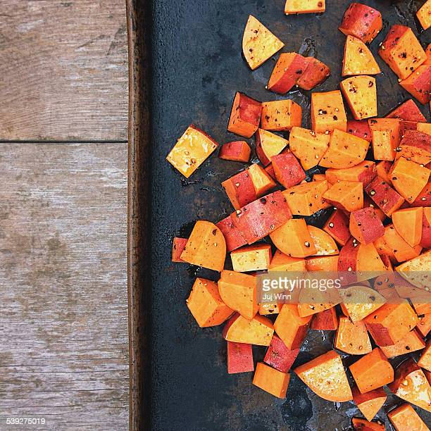 Cubed sweet potatoes on a roasting pan