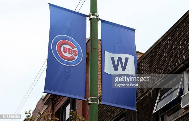 Cubs banner and 'W' banner hangs on Clark Street outside Wrigley Field home of the Chicago Cubs baseball team to celebrate the Cubs' World Series...