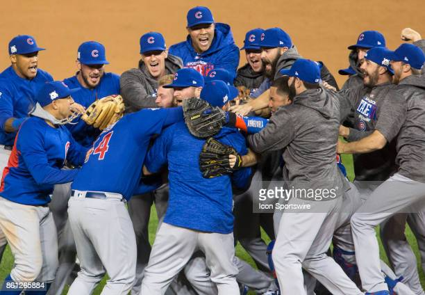Cubs celebrate their victory at the end of game five of the NLDS between the Washington Nationals and the Chicago Cubs on October 12 at Nationals...