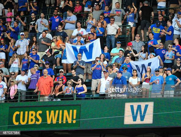 Cubs fans celebrate the Cubs win against the Arizona Diamondbacks on September 5 2015 at Wrigley Field in Chicago Illinois The Cubs won 20