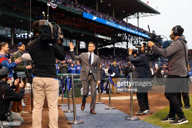 Cubs President of Baseball Operations Theo Epstein takes the field for the World Series ring ceremony ahead of the game between the Los Angeles...