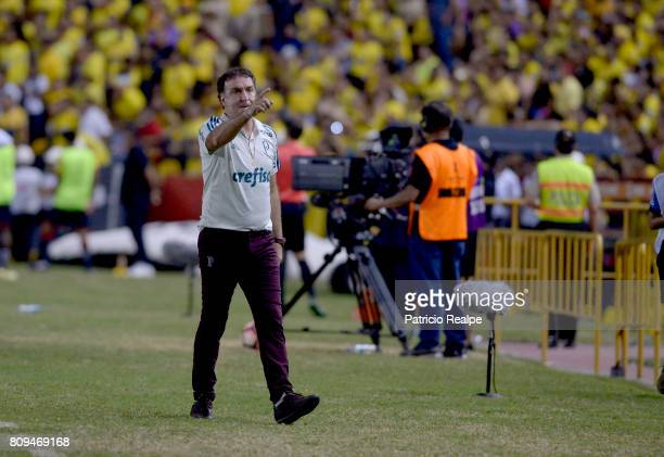 Cuca coach of Palmeiras gives instructions to his players during a first leg match between Barcelona SC and Palmeiras as part of round of 16 of Copa...