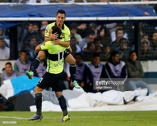 Cuciano Acosta and Juan Sanchez Miño of Boca celebrate after score the first goal during a match between Gimnasia and Boca as part of the 19th round...