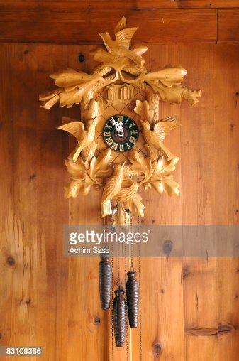 Cuckoo clock on wooden wall, close-up