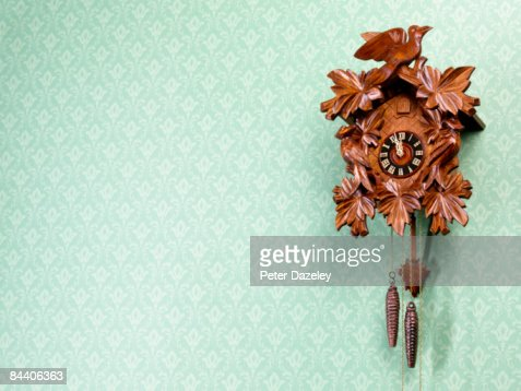 Cuckoo-Clock against wallpapered wall