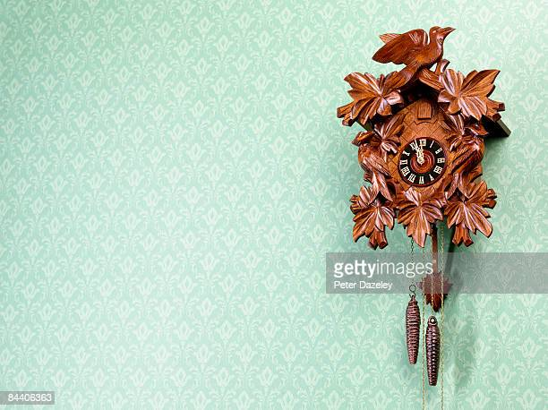 Cuckoo-Clock against wallpapered wall