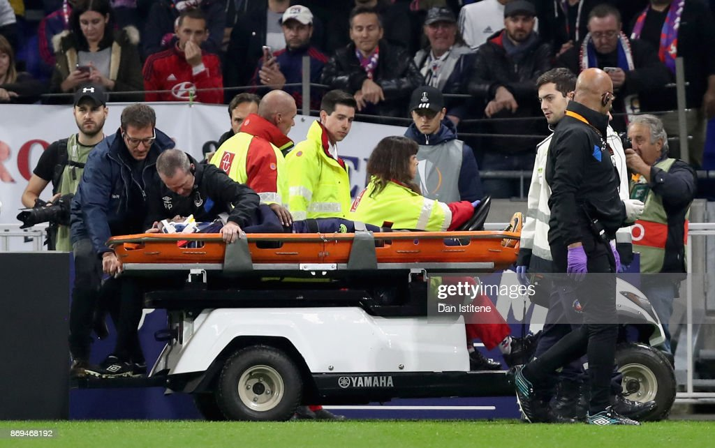 Cuco Martina of Everton is stretchered off injured during the UEFA Europa League group E match between Olympique Lyon and Everton FC at Stade de Lyon on November 2, 2017 in Lyon, France.