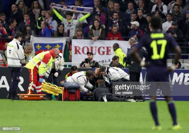 Cuco Martina of Everton receives treatment from the medical team during the UEFA Europa League group E match between Olympique Lyon and Everton FC at...