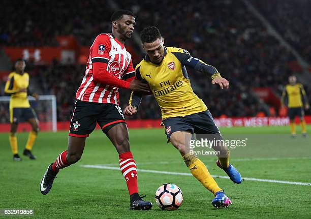 Cuco Martina of Southampton and Kieran Gibbs of Arsenal in action during the Emirates FA Cup Fourth Round match between Southampton and Arsenal at St...