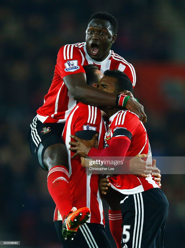 <a gi-track='captionPersonalityLinkClicked' href=/galleries/search?phrase=Cuco+Martina&family=editorial&specificpeople=8606289 ng-click='$event.stopPropagation()'>Cuco Martina</a> of Southampton (R) celebrates with <a gi-track='captionPersonalityLinkClicked' href=/galleries/search?phrase=Victor+Wanyama&family=editorial&specificpeople=7126412 ng-click='$event.stopPropagation()'>Victor Wanyama</a> (L) and Jose Fonte (C) as he scores their first goal with a long range shot during the Barclays Premier League match between Southampton and Arsenal at St Mary's Stadium on December 26, 2015 in Southampton, England.