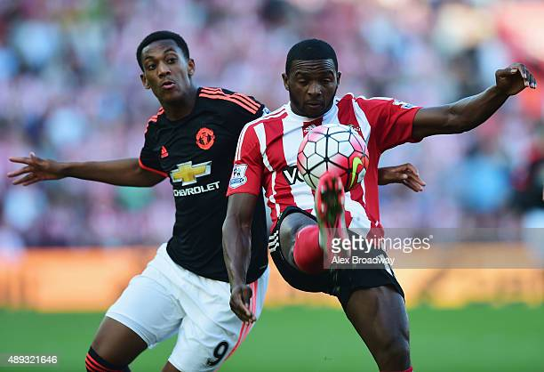 Cuco Martina of Southampton clears the ball from Anthony Martial of Manchester United during the Barclays Premier League match between Southampton...