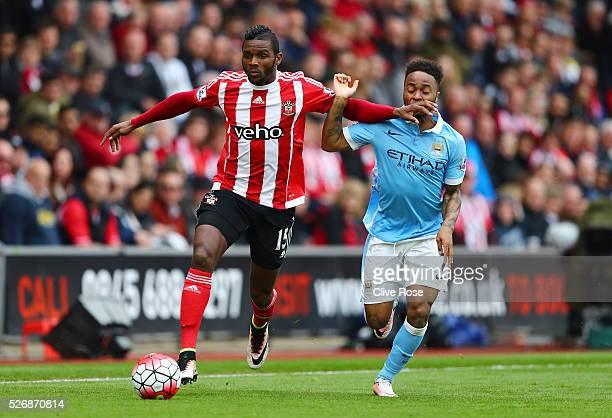 Cuco Martina of Southampton holds off Raheem Sterling of Manchester City during the Barclays Premier League match between Southampton and Manchester...