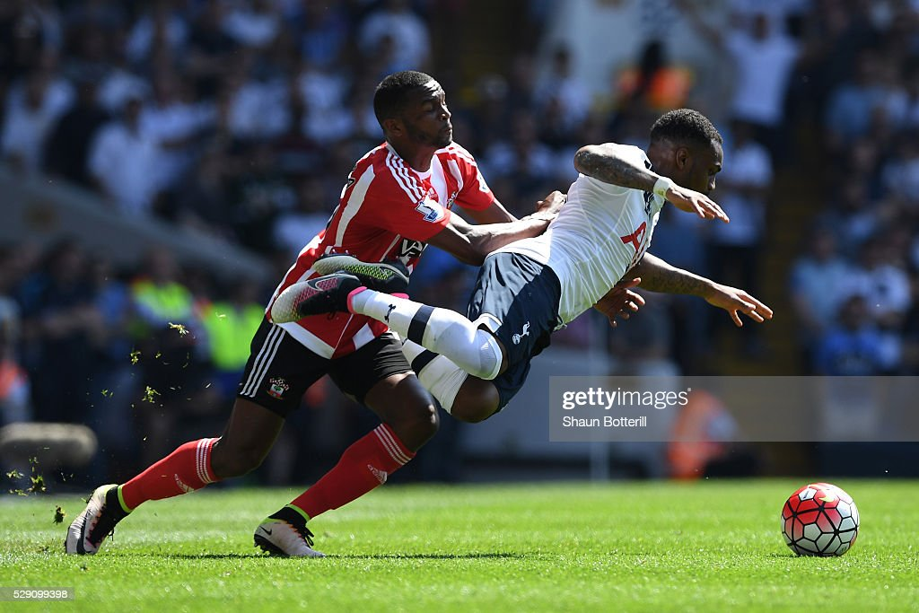 Cuco Martina of Southampton makes a tackle on Danny Rose of Tottenham Hotspur during the Barclays Premier League match between Tottenham Hotspur and Southampton at White Hart Lane on May 8, 2016 in London, England.