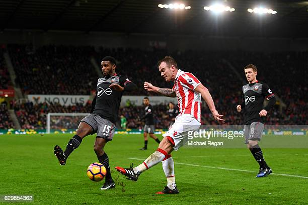 Cuco Martina of Southampton put pressure on Glenn Whelan of Stoke City during the Premier League match between Stoke City and Southampton at Bet365...