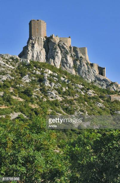 Queribus Castle fortress set high up on a rocky peak at an elevation of 728m under the blue sky