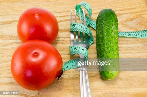 Cucumber and tomato with measuring : Stock Photo