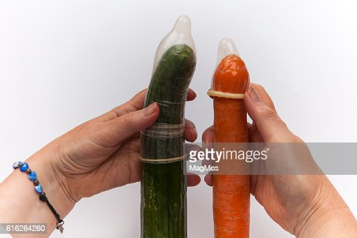 Cucumber, carrot and condoms : Stock Photo