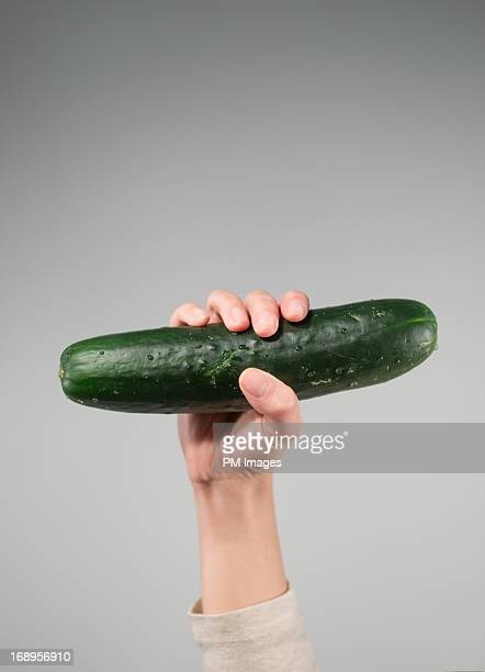 Cucumber in woman's hand