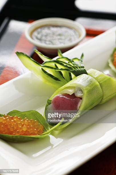 Cucumber rolls with tuna fish and char caviar with wasabi dip