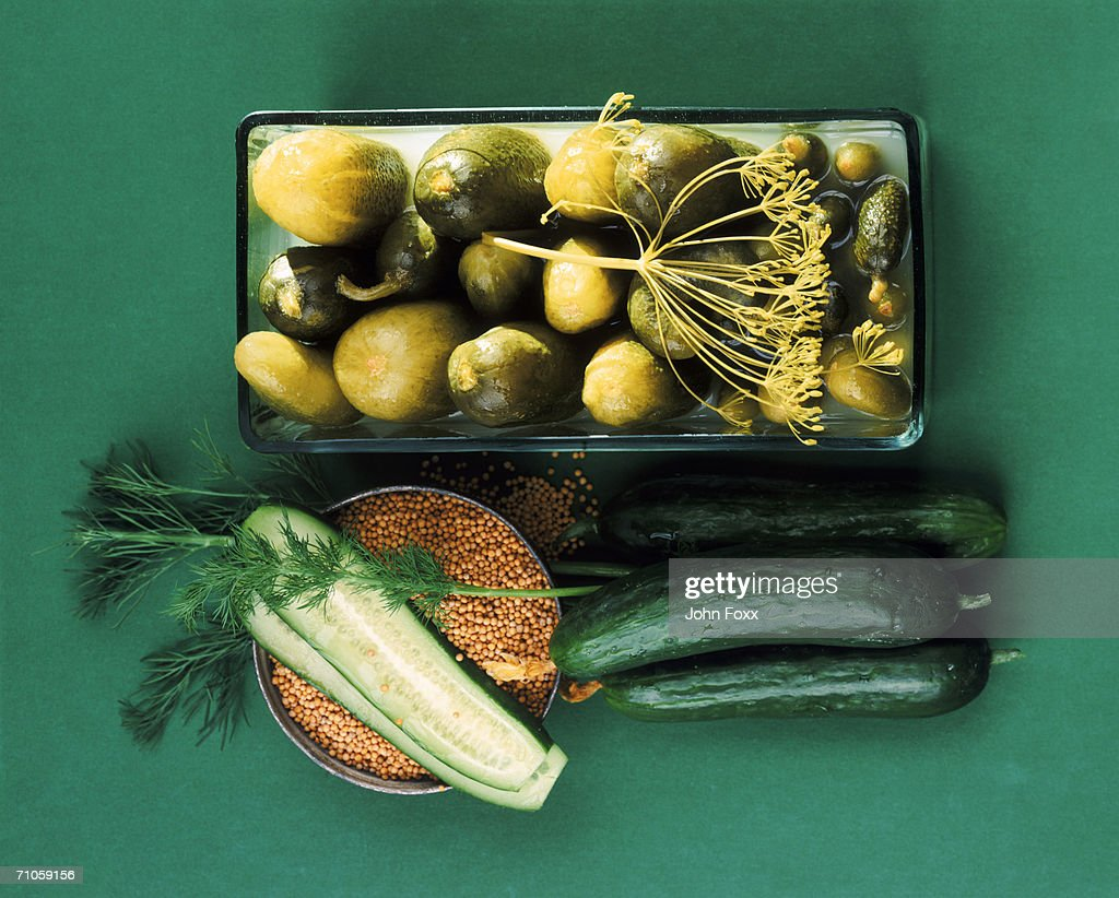 Cucumber with pickle, directly above : Stock Photo
