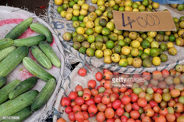 Cucumbers tomatoes and passion fruit for sale at Khua Din morning market in Vientiane city Lao PDR A large variety of local products are available...