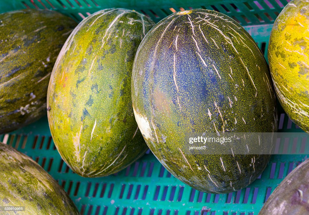 Cucumis melo box of melons : Stock Photo