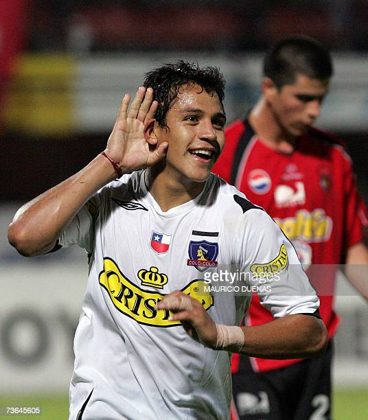 Alexis Sanchez of Chile's Colo Colo celebrates after scoring against Venezuela's Caracas during their Libertadores Cup football match 20 March 2007...