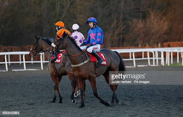 Cue Card ridden by Paddy Brennan after Thistlecrack ridden by Tom Scudamore won The 32Red King George VI Steeple Chase Race run during day one of the...