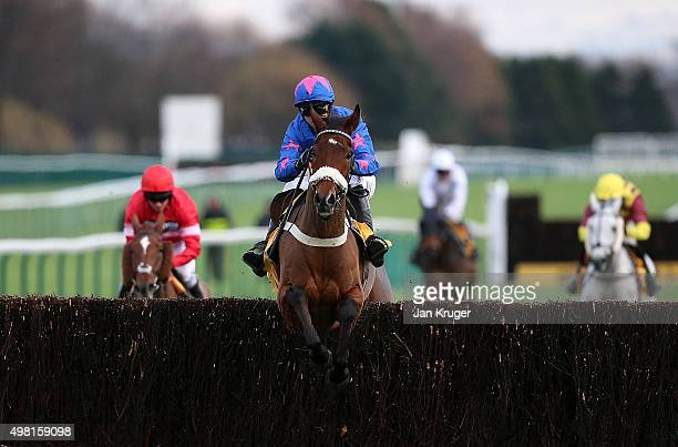 Cue Card ridden by Paddy Brennan jumps the last to win The Betfair Steeple Chase at Haydock racecourse on November 21 2015 in Haydock England