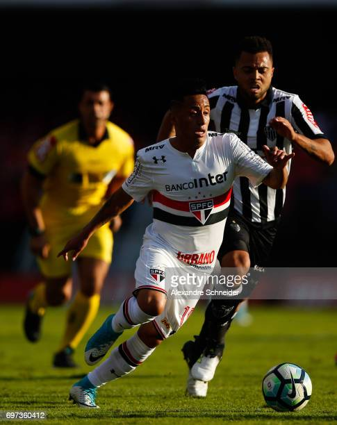Cueva of Sao Paulo and rafael Carioca of Atletico MG in action during the match between Sao Paulo and Atletico MG for the Brasileirao Series A 2017...
