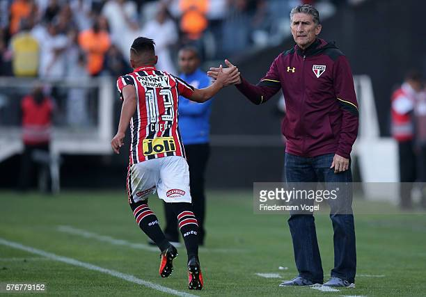 Cueva of Sao Paulo celebrates scoring the first goal with head coach Edgardo Bauza during the match between Corinthians and Sao Paulo for the...