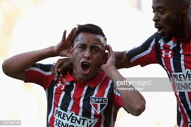 Cueva of Sao Paulo celebrates scoring the first goal with Michel Bastos during the match between Corinthians and Sao Paulo for the Brazilian Series A...