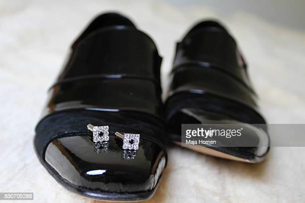 Cuff links on glossy black shoes, detail, Zagreb, Croatia