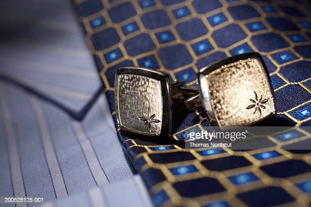 Cuff links, tie and button down shirt, close-up