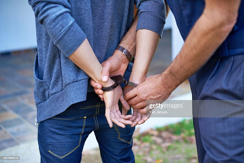 Cuffing a criminal : Stock Photo