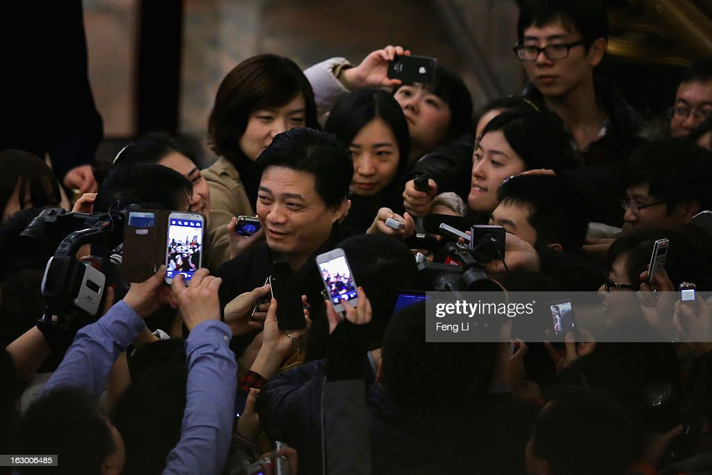Cui Yongyuan (Center) , Chinese famous TV host, walks through a swarm of journalists after attending the opening session of the Chinese People's Political Consultative Conference in Beijing's Great Hall of the People on March 3, 2013 in Beijing, China. Over 2,000 members of the 12th National Committee of the Chinese People's Political Consultative, a political advisory body, are attending the annual session, during which they will discuss the development of China.