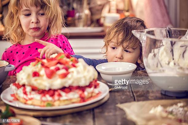 Cule Kids Eating Berry Pavlova Cake with Strawberries and Raspberries