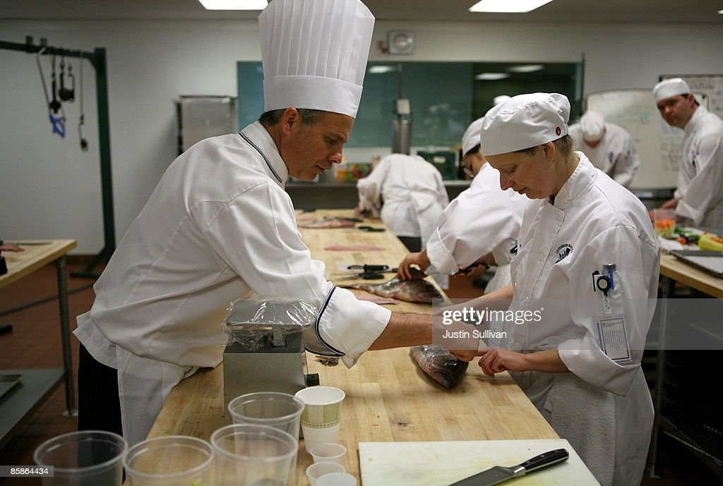 Culinary instructor Chef Matt Cosenza (L) shows Joanna Terry how to filet a fish during a butchery class at the Le Cordon Bleu program at California Culinary Academy April 8, 2009 in San Francisco, California. Popularity of food shows and an increase in concern over food safety has many people considering a career in the food industry which offers a broad range of jobs from food critics to chefs. In 2008, the Institute of Culinary Education saw a 12 percent increase in enrollment inquiries.