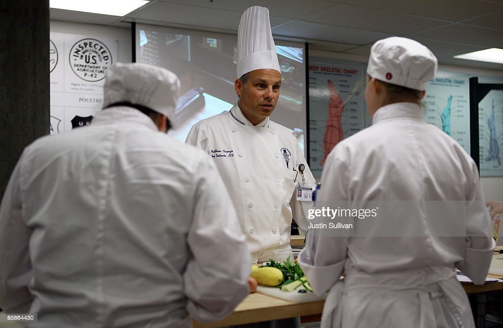 Culinary instructor Chef Matt Cosenza (C) talks to students during a butchery class at the Le Cordon Bleu program at California Culinary Academy April 8, 2009 in San Francisco, California. Popularity of food shows and an increase in concern over food safety has many people considering a career in the food industry which offers a broad range of jobs from food critics to chefs. In 2008, the Institute of Culinary Education saw a 12 percent increase in enrollment inquiries.
