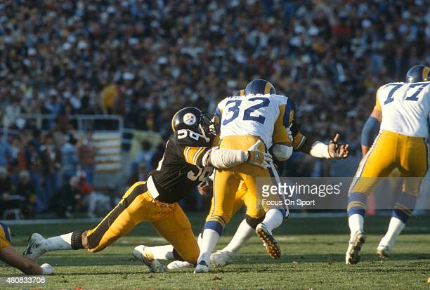 Cullen Bryant of the Los Angeles Rams gets tackled by Jack Lambert of the Pittsburgh Steelers during Super Bowl XIV on January 20 1980 at the Rose...